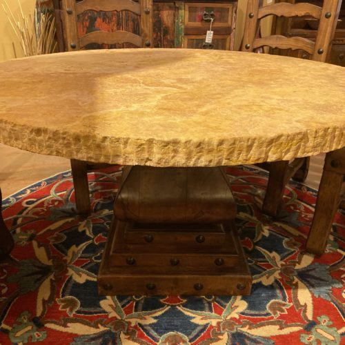 Round Chiseled Edge Travertine Table on Mesquite Pedestal