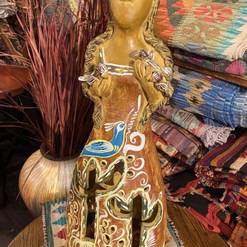 lady with birds lantern